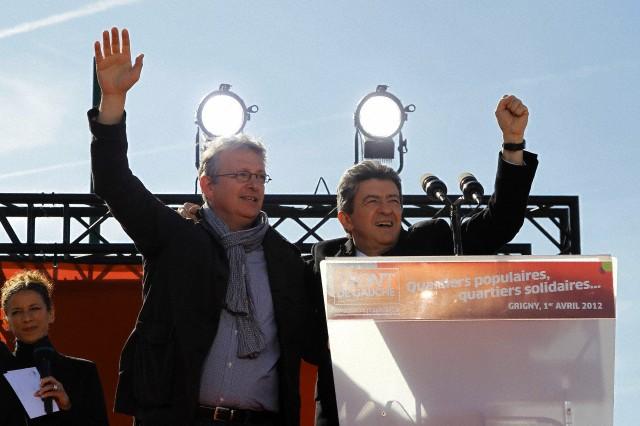 1 avril 2012, la France --- Jean-Luc Mélenchon et Pierre Laurent, chef du parti communiste français, arrivent pour assister à un rassemblement politique à Grigny, près de Paris, le 1er Avril 2012. --- Image par © GONZALO FUENTES / Reuters / Corbis