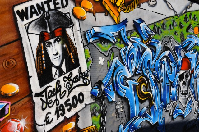 Avril 2011, Paris, France --- murale illustration Nicolas Sarkozy comme le pirate Jack Sparrow, à Montreuil, près de Paris. --- Image par © Frédéric Soltan / Corbis