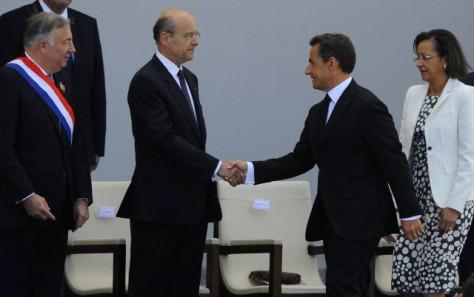 4 juillet 2011, Paris, France. Ancien ministre des affaires étrangères Alain Juppé et l'ancien Président français Nicolas Sarkozy. © Neil Marchand/Liewig Media Sports/Corbis
